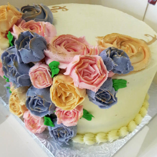 Vanilla cake with multi coloured flowers