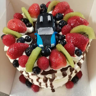 fresh fruit, cream, chocolate drip cake includes Model fondant car