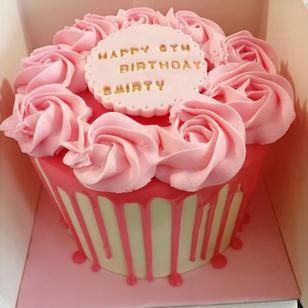 Vanilla rossette, white chocolate drip cake