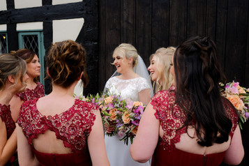 Laughs with the bride and her bridesmaids