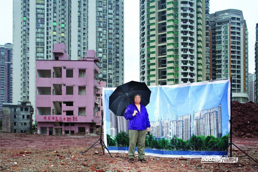 Former Yangjicun Resident Posing in Front of Promotional Poster
