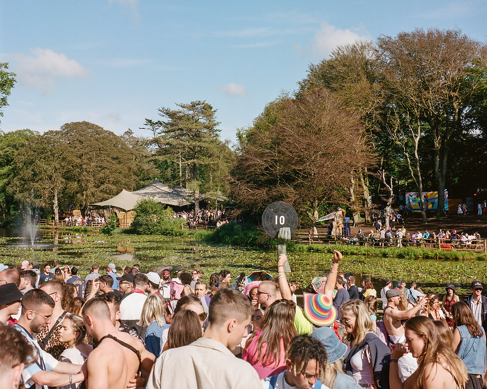 The lawn stage and lake At Gottwood Festival. Events, Festival Anglesey, Music Photography. Photo taken by Rob Jones @hirobjones