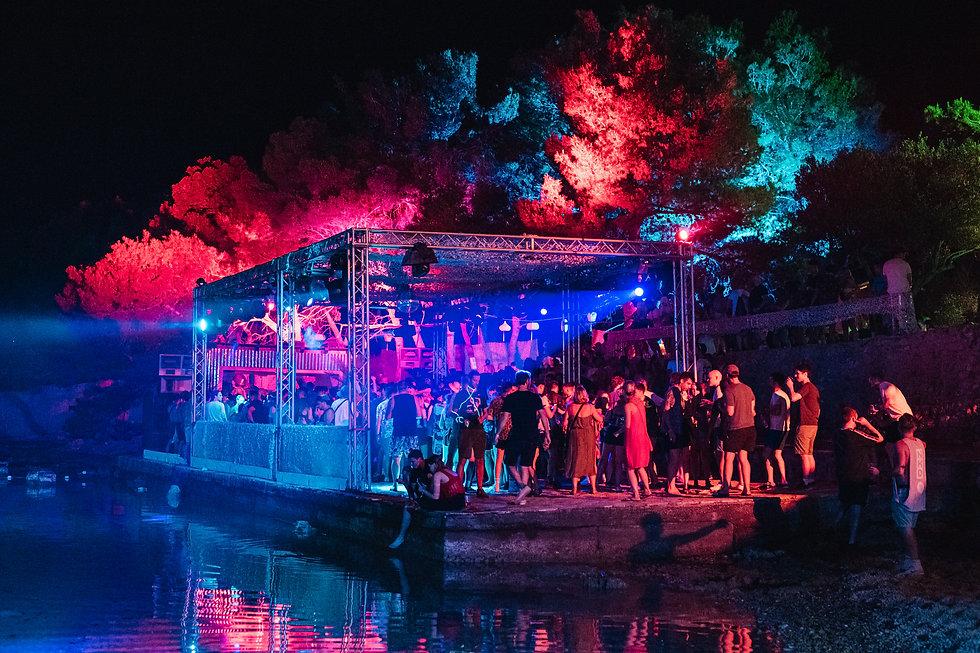 Beach stage at night At Love International Festival. Events, Festival Tisno, Music Photography. Photo taken by Rob Jones @hirobjones