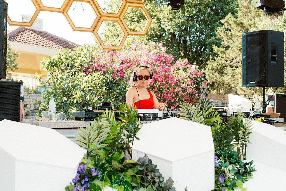 Jessica DJ on the Olive Grove stage At Love International Festival. Events, Festival Tisno, Music Photography. Photo taken by Rob Jones @hirobjones