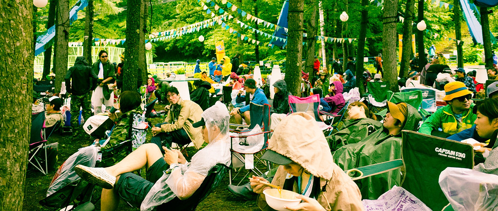 Festival goers relaxing in the forest.