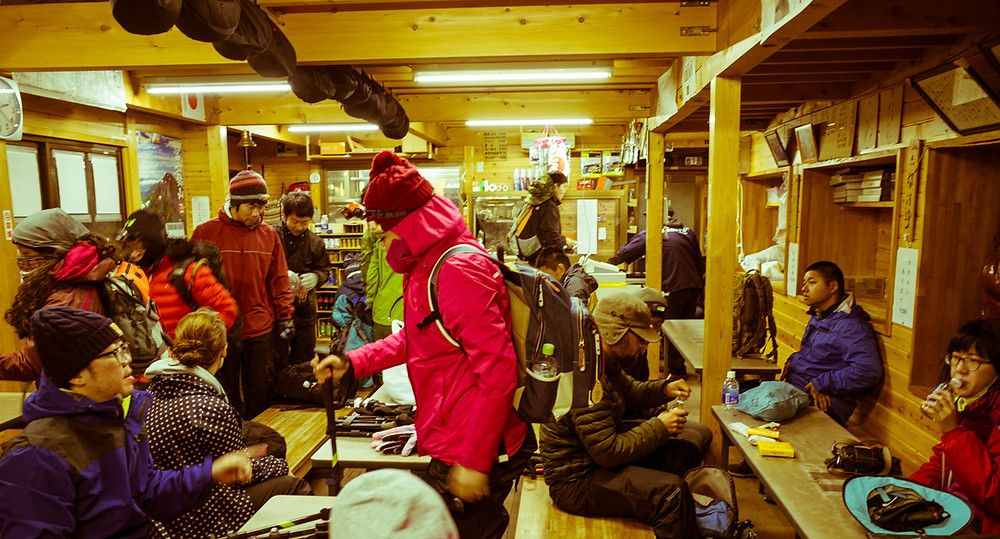 Climbers leaving the Fujisan Hotel at 2am in the morning for sunrise.