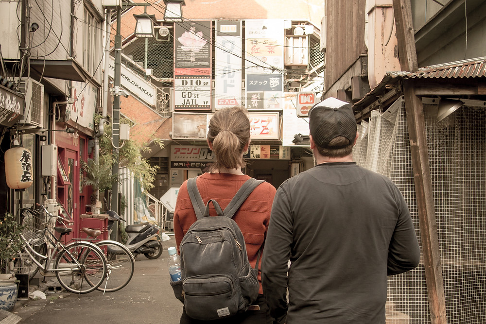 Two tourists on a street food tour of Tokyo.