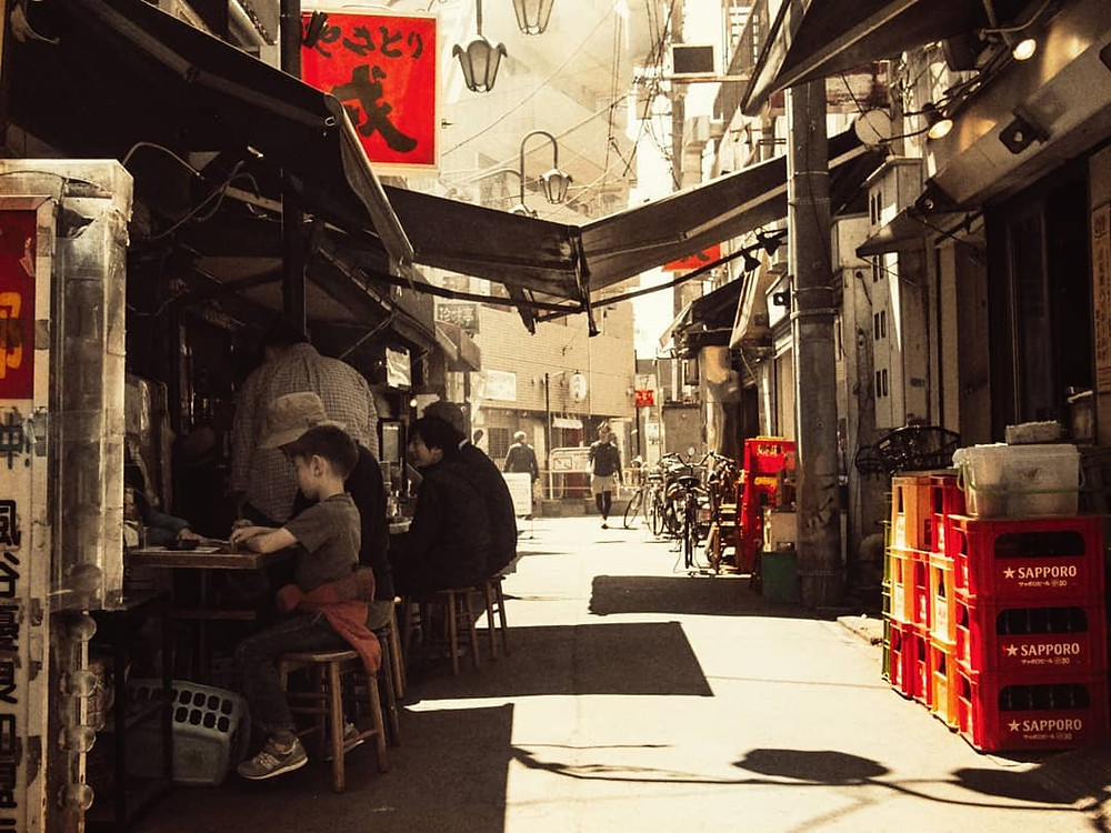 Customers eating and drinking at Yakitori Ebisu in Nishi-Ogikubo, Tokyo