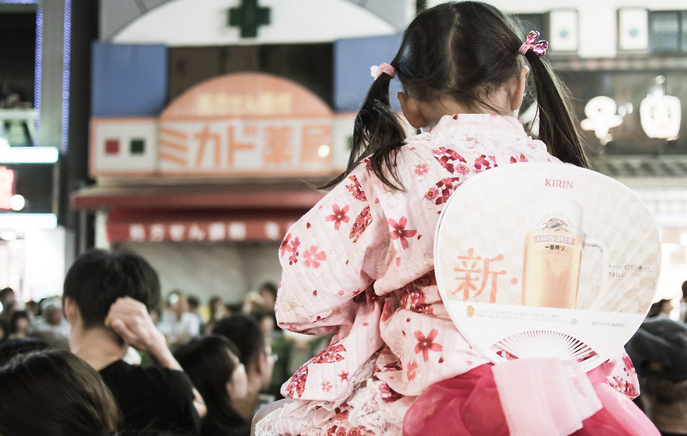 Japanese girl in summer yukata in Koenji, Tokyo.
