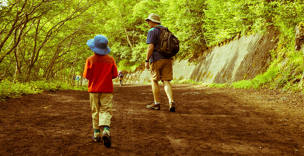 My son and father hiking along the road to the entrance to the Yoshida Trail.