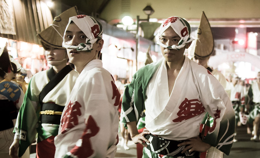 Japanese men dressed in their traditional awa odori outfits.
