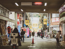Navigate the crowds in the busy shopping and entertainment hubs