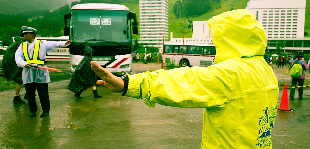 Fuji Rock Festival staff ushering pedestrians safely to the entrance