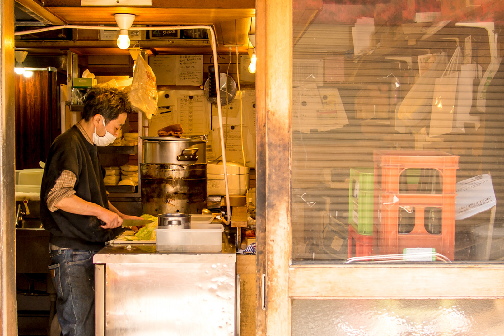 Pass by local izakayas preparing for the evening rush