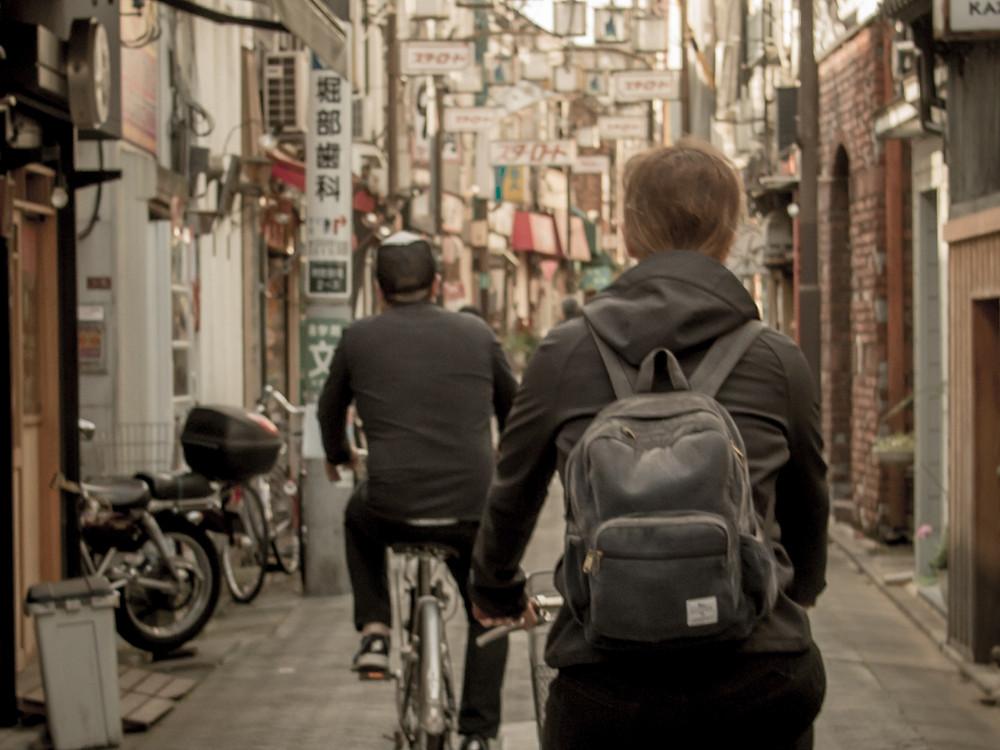 Tourists riding Japanese bikes down Asagaya Star Road.