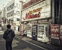 A man walking past a Pachinko Palor in Shimokitazawa