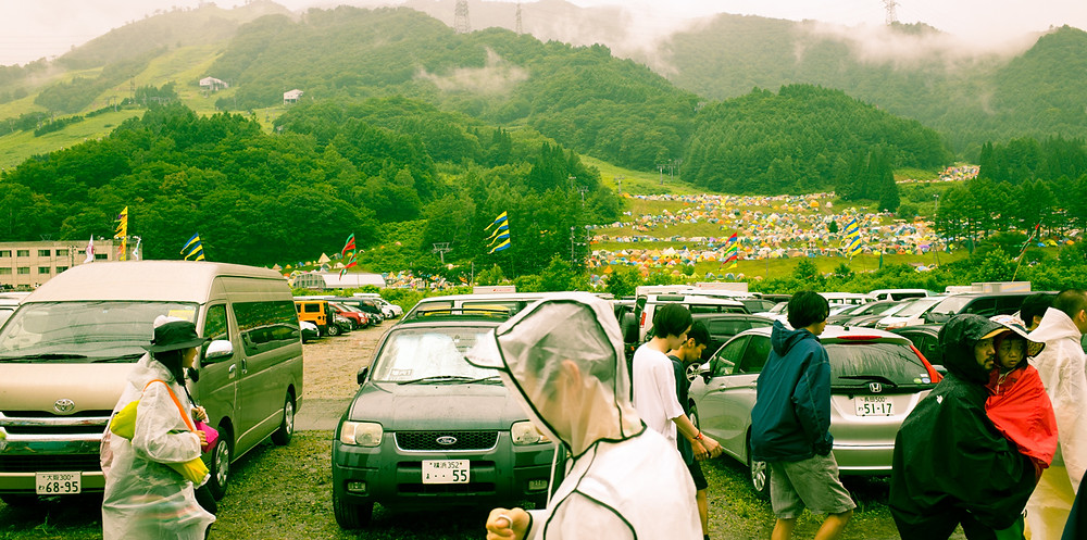 Tents propped on the side of the mountain at Fuji Rock Festival.