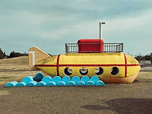 A yellow submarine inspired piece of play equipment in a Japanese park