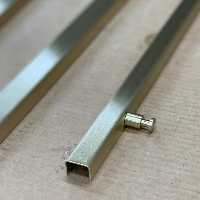 Machined brass hanging system.