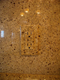 KItchen Hand painted switch place to match granite back splash