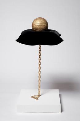 Hoop Dreams, 2011 gold basketball, velvet pillow, steel chain and shackle