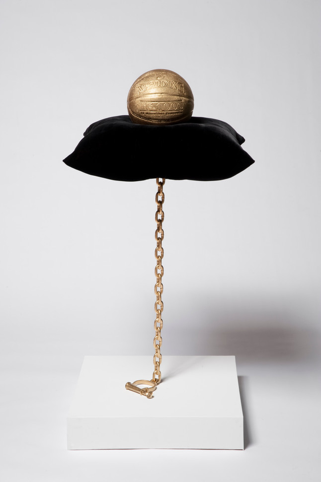 Hoop Dreams, 2011 gold basketball, velvet pillow, steel chain and shackle