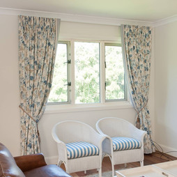 Pinch pleat curtains with 3 pass lining on a classic rod