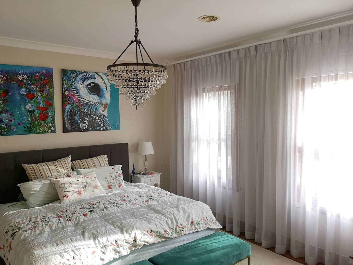 Pinch pleat sheer curtains on a classic rod over blockout roller blinds