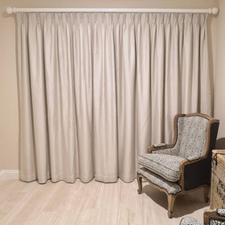 Pinch pleat curtains on a classic rod