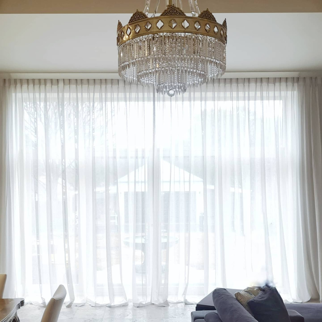 Floor to ceiling pinch pleat sheer curtains