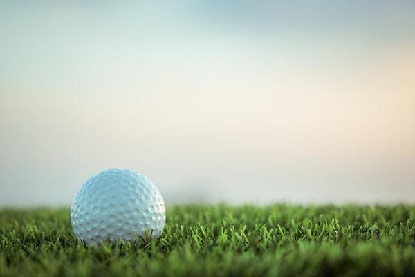 golf-ball-grass-sky-background_36650-71.