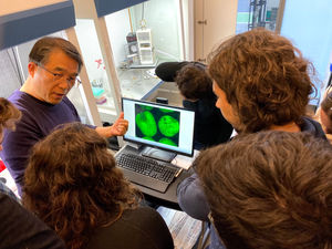 Myeong-Je Cho, Ph.D., Director and PI of Plant Genomics and Transformation Facility, shows some cool science to students