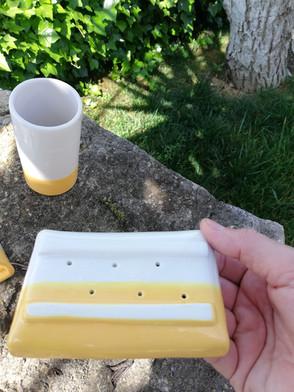 Onderkant zeepbakje geel