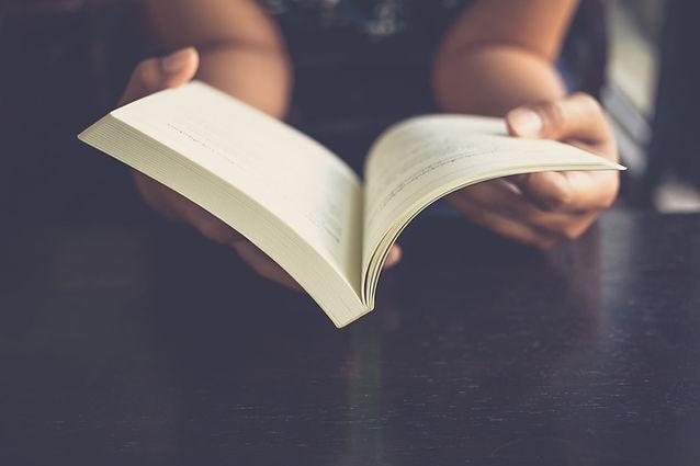 woman holding book.jpg