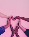 diverse hands form a heart.jpeg