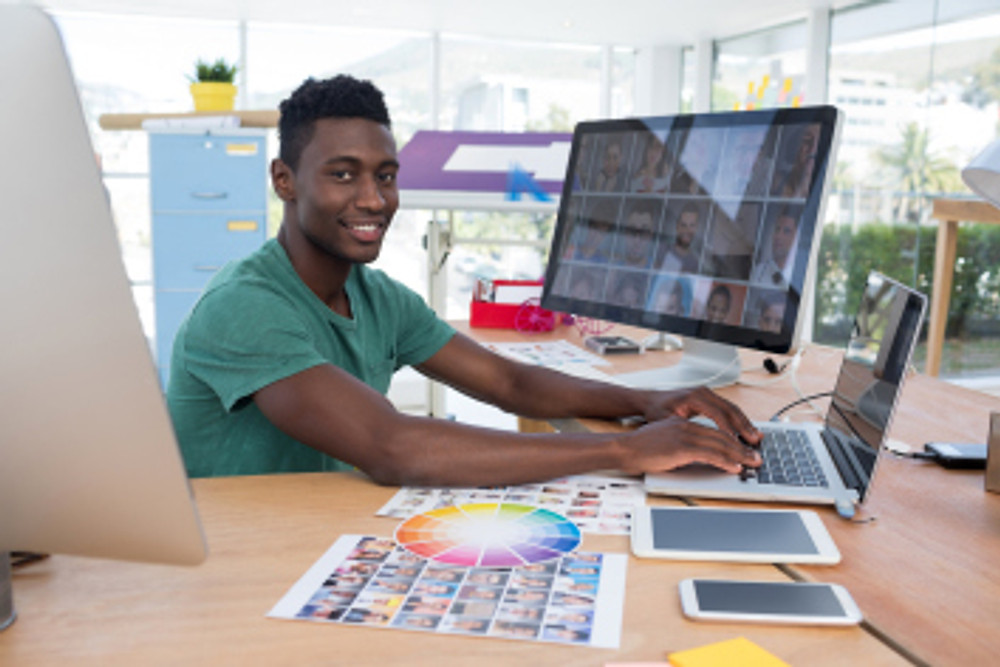 Smiling executive working on laptop in office