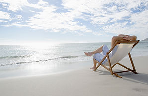 Decorativ Stock Image of a Woman Sitting on a Beach Chair on the Shorelie