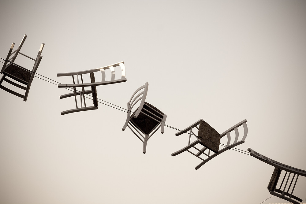 sculpture made of several chairs