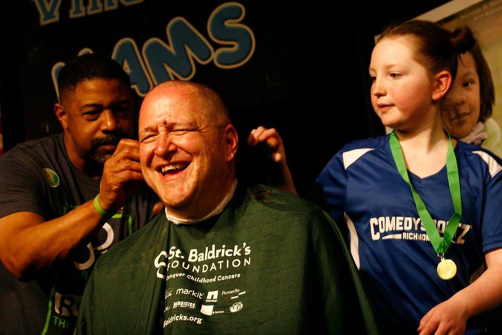 Jay Hart having his head shaved.