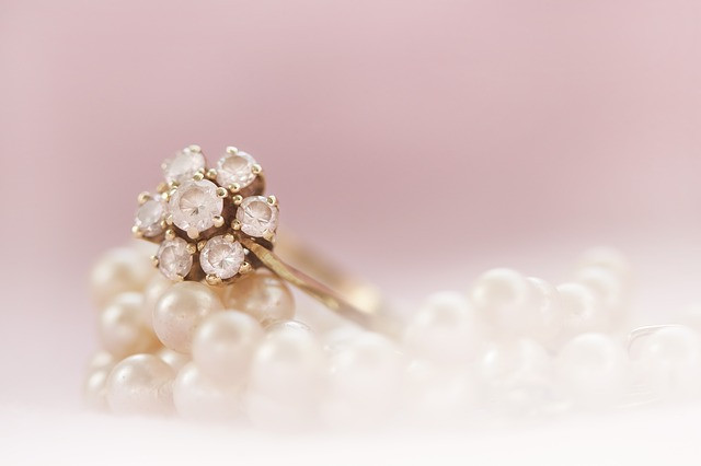 diamond ring resting on pearls