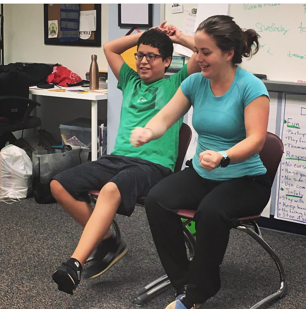 autistic child learning improv with a teacher