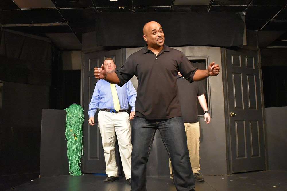 Damon Mitchell performing improv on stage.