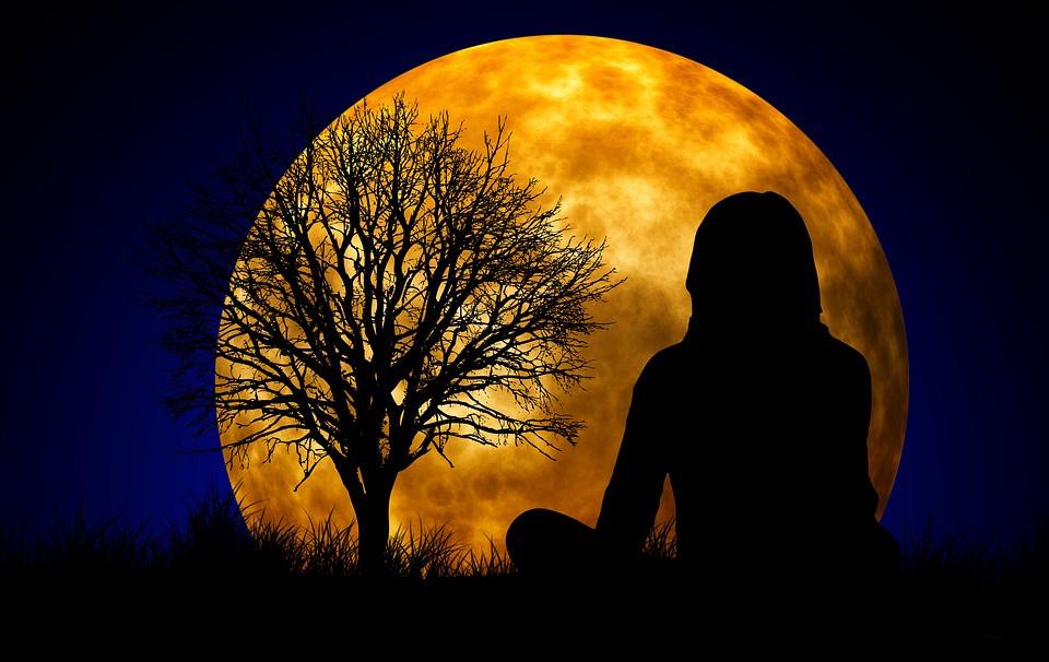 women meditating at night