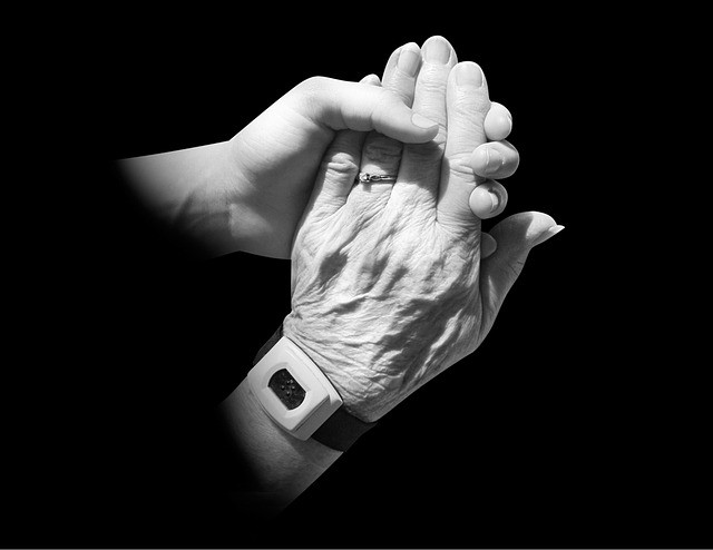 young and old hands holding each other