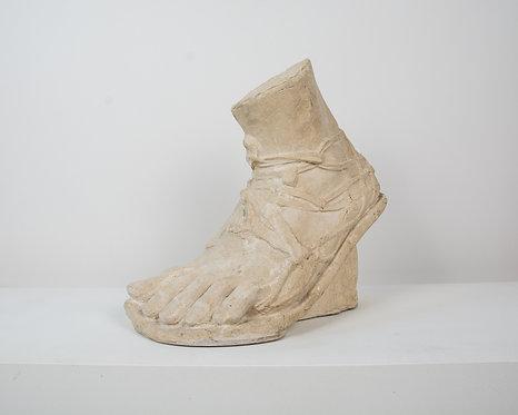 Roman foot in stucco
