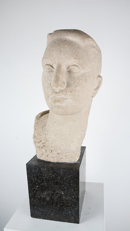 Hand cut bust in granite from young man
