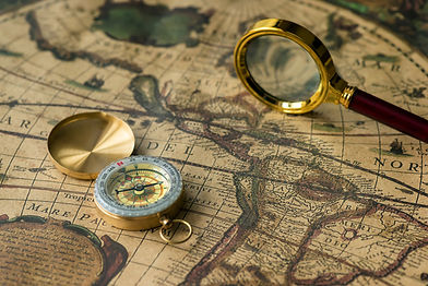 retro-compass-with-old-map-and-magnifier