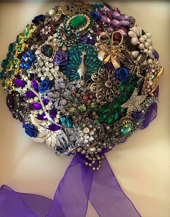 Peacock themed brooch bouquet.