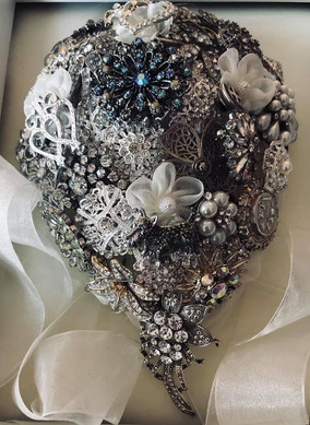 Silver antique themed brooch bouquet.