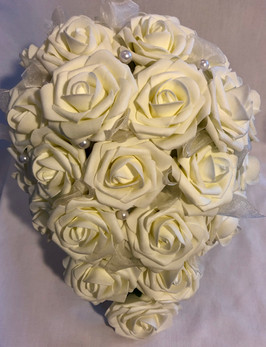 Ivory roses with mesh ribbon and pearls.